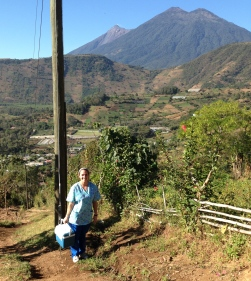 Katie climbing to the villages on top of the city hills to give vaccinations