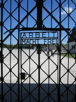 "The gate to Dachau Concentration Camp in Germany. It reads ""Work makes you free."" Photo by Dan Ruland, used with permission by the Honors Program at Ferris State"