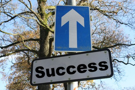 The word 'success' placed over a one-way street sign: Based on CC-licensed work from wikimedia commons