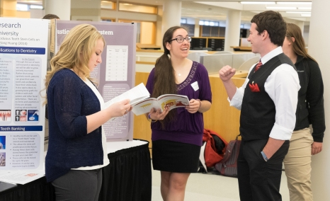 Nicole Christy and Vanessa Colletti with their posters at the Senior Symposium 2015, Photo from Ferris SmugMug Gallery http://ferrisphotos.smugmug.com/Academic/Honors/2015-Senior-Symposium-Poster/