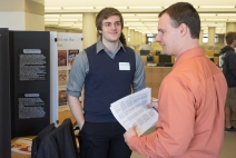 Zachary Walters fields questions on his poster to Honors advisor Charlie Malone at the Senior Symposium 2015, Photo from Ferris SmugMug Gallery http://ferrisphotos.smugmug.com/Academic/Honors/2015-Senior-Symposium-Poster/