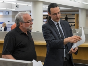 Dr. Bradley and Professor Noren discussing strategy for evaluating posters. Senior Symposium 2015, Photo from Ferris SmugMug Gallery http://ferrisphotos.smugmug.com/Academic/Honors/2015-Senior-Symposium-Poster/