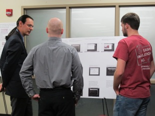 Dalton White explains his poster. Courtesy of the photographer.