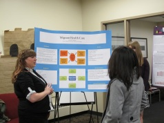 Jennifer Polglaze explains her poster. Courtesy of the photographer.