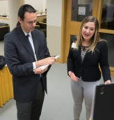 Honors student explains her Senior Symposium poster to Dr. Peter Bradley. Courtesy of Ferris State University's SmugMug.