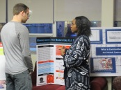 Pasha Riggins presents her poster. Courtesy of the photographer.