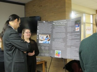 Tara Erwin presents her poster. Courtesy of the photographer.