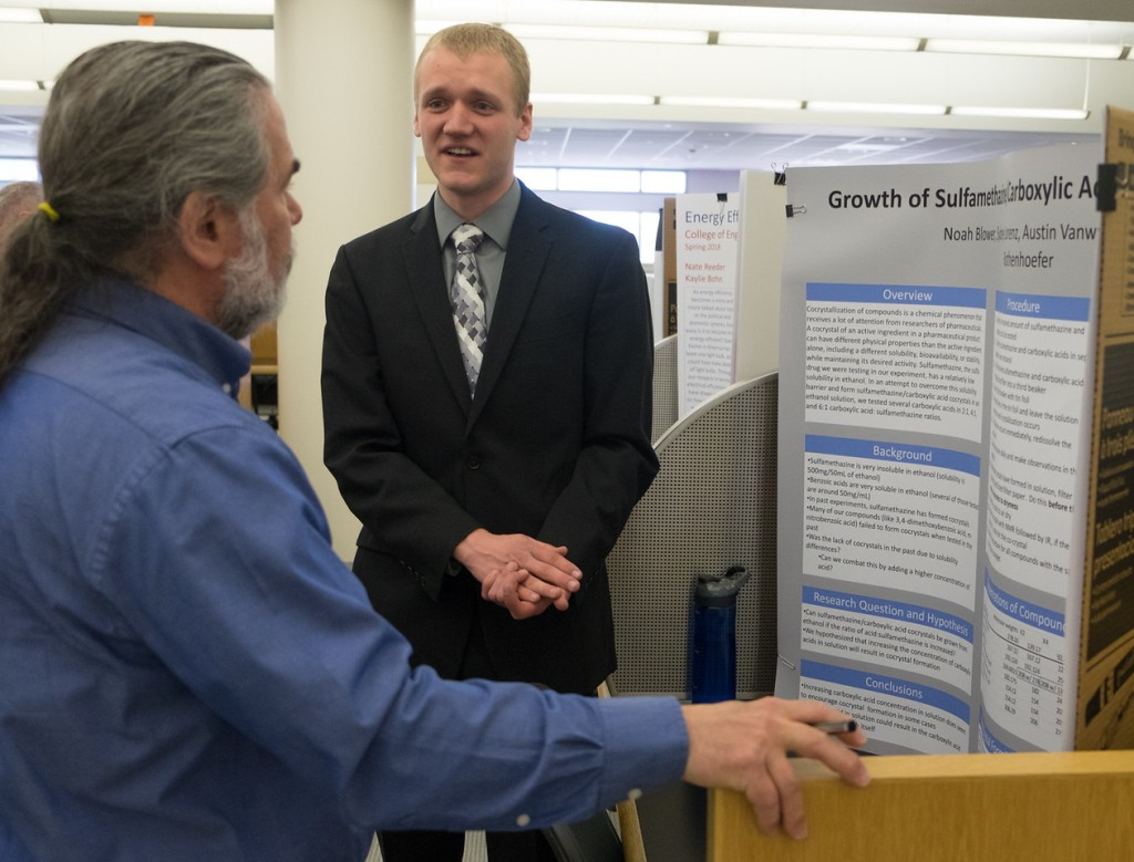 Noah Blower presents his poster to John Cullen at the 2018 Honors's Senior Symposium. Courtesy of the Ferris State SmugMug.