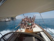 Lilly George with friends on a boat. Courtesy of Honors student, Lilly George.