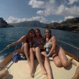Lilly George on a boat with friends. Courtesy of Honors student, Lilly George.